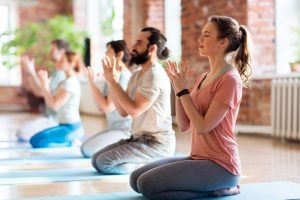 group of people meditating at yoga studio or retreat center